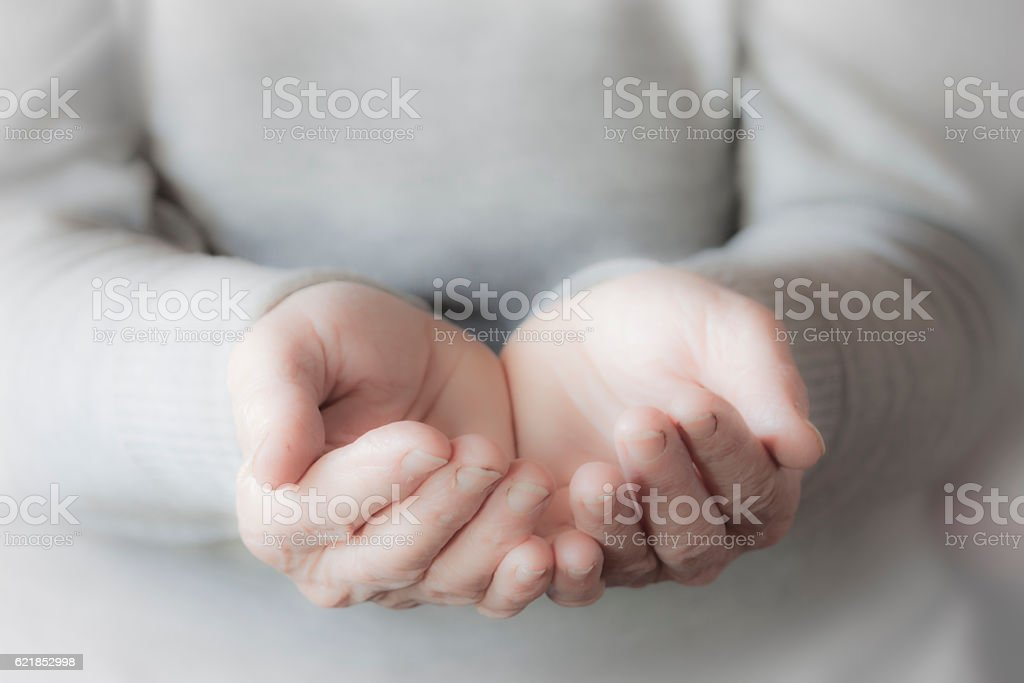 Woman's hand waiting for alms stock photo
