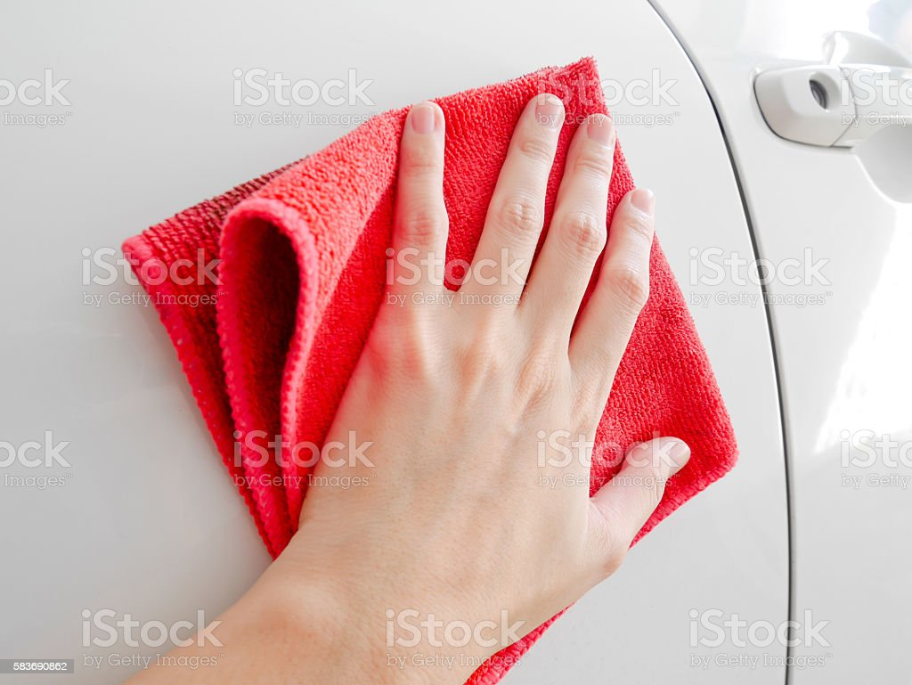 Woman's hand wiping a car stock photo