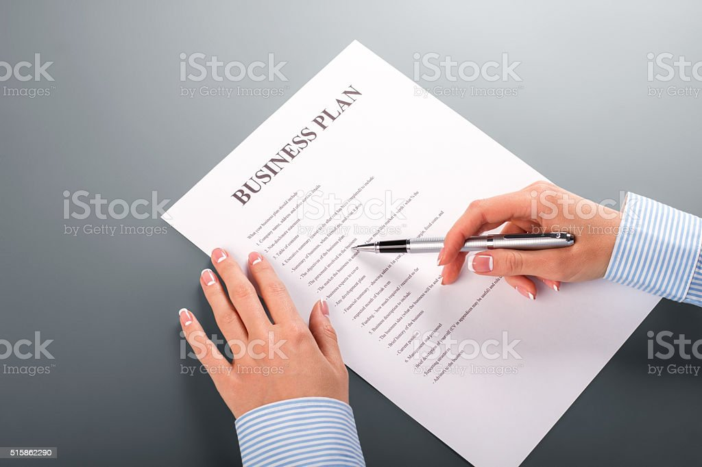 Woman's hand with business plan. stock photo