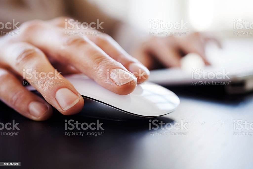 Womans Hand With Computer Mouse stock photo