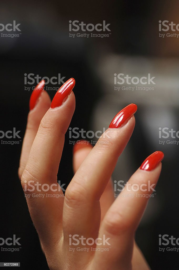 A woman's hand with red nail polish royalty-free stock photo