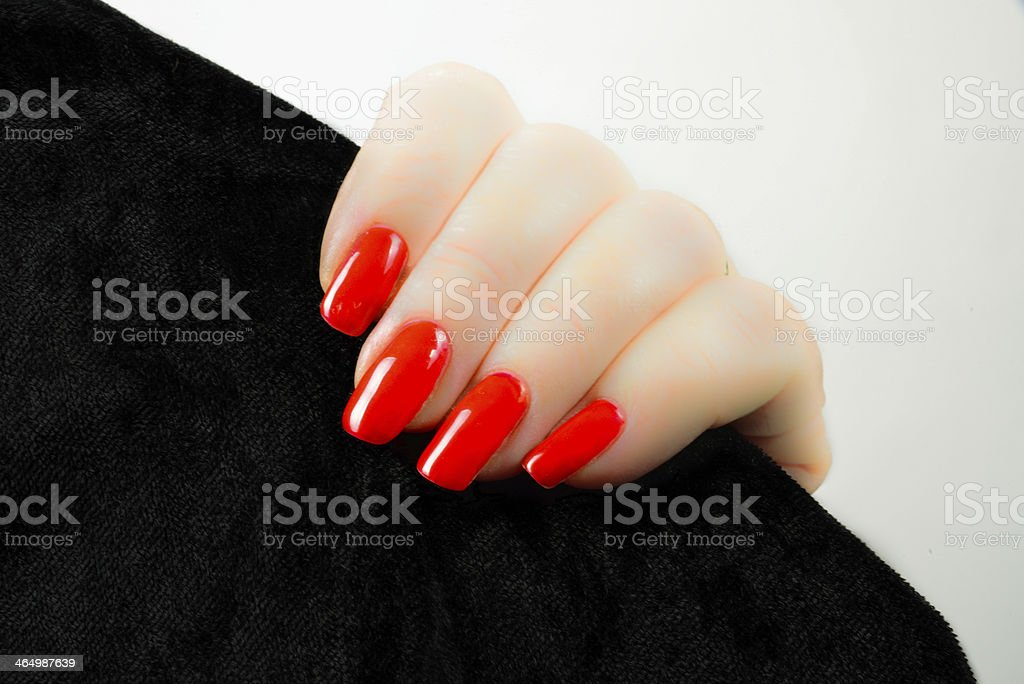woman's hand with red nails stock photo