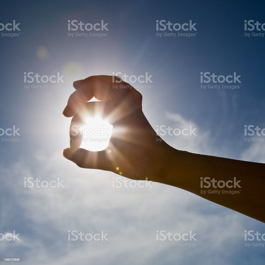 Woman's Hand With Sun and Sky Behind It royalty-free stock photo