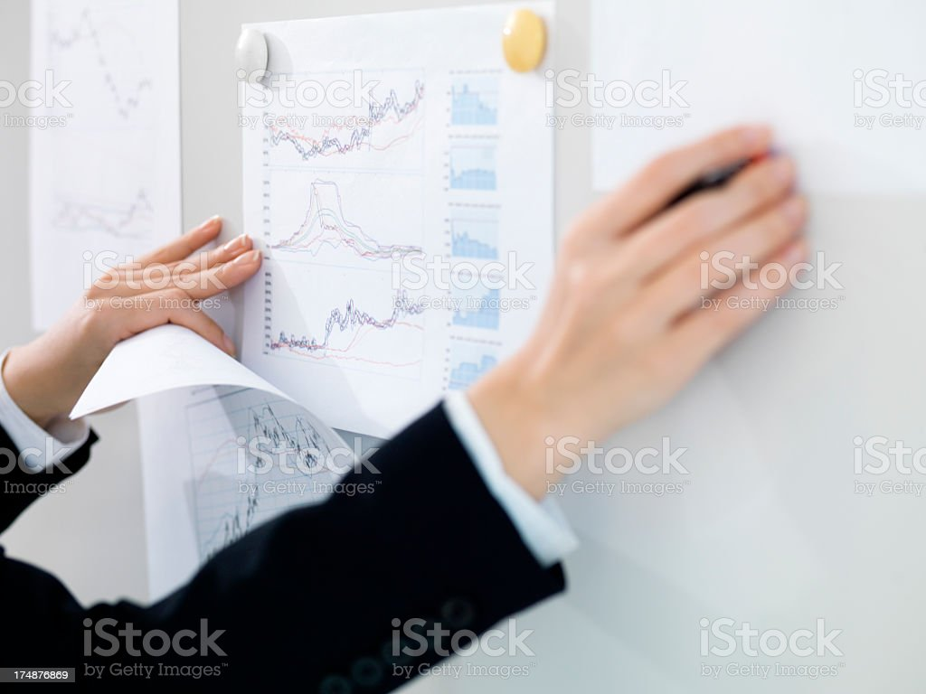 Woman's hand working at meeting. royalty-free stock photo