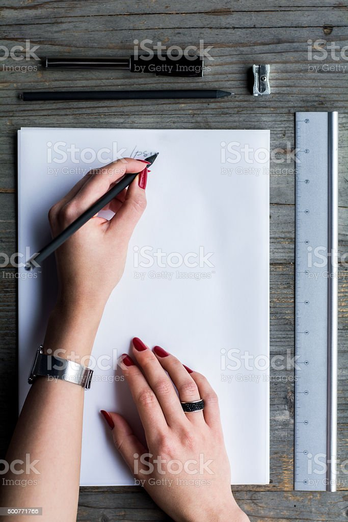 Woman's hand writing on white paper stock photo
