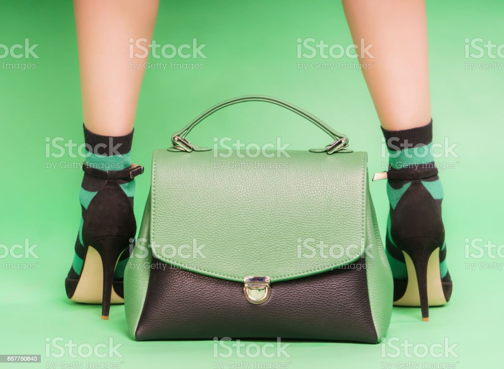 Woman's handbag in green and black colors stock photo