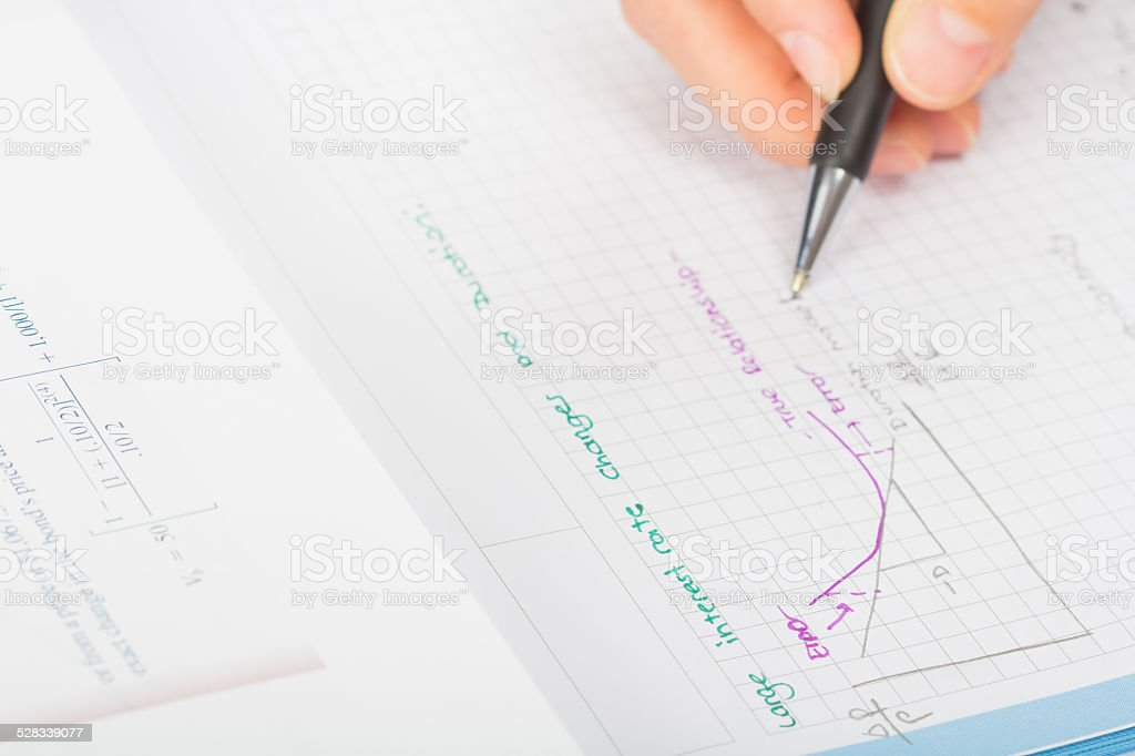 woman's hands a pen, financial statement accounting stock photo