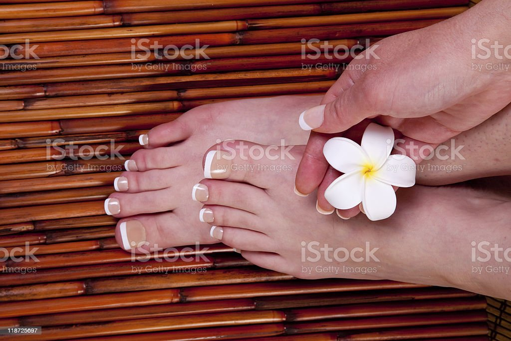 Woman's hands and feet stock photo