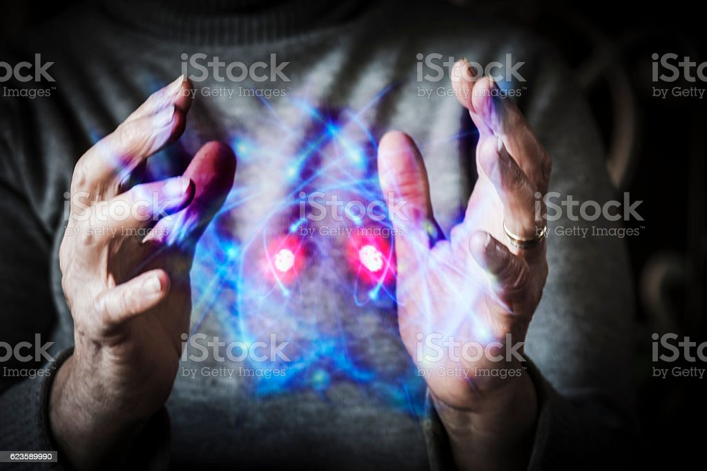 Woman's hands controlling atomic energy stock photo