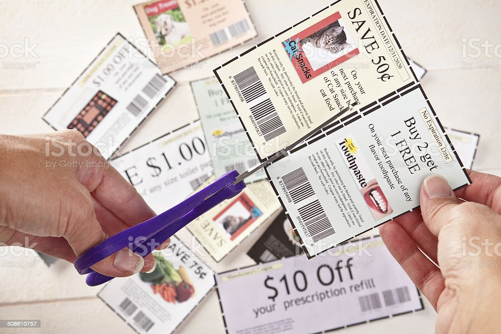 Woman's Hands Cutting Coupons stock photo
