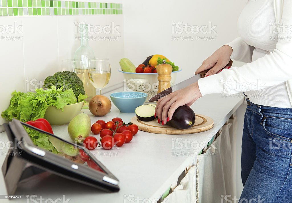 Woman's hands cutting vegetables royalty-free stock photo