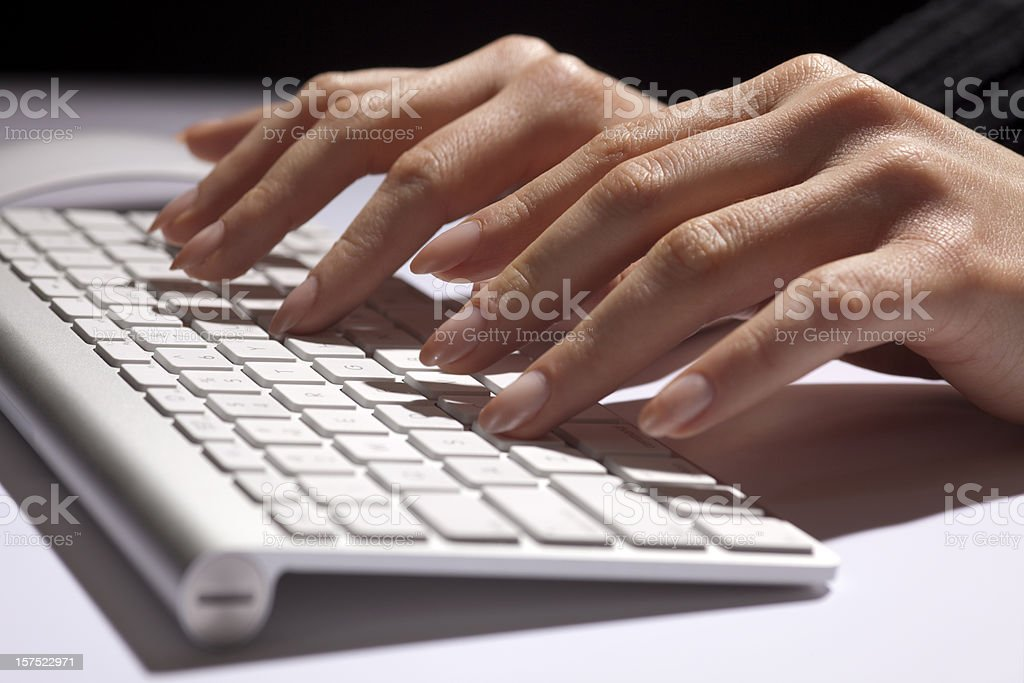 Woman's Hands Fingers Typing, Data Entry, Modern White Aluminum Keyboard royalty-free stock photo