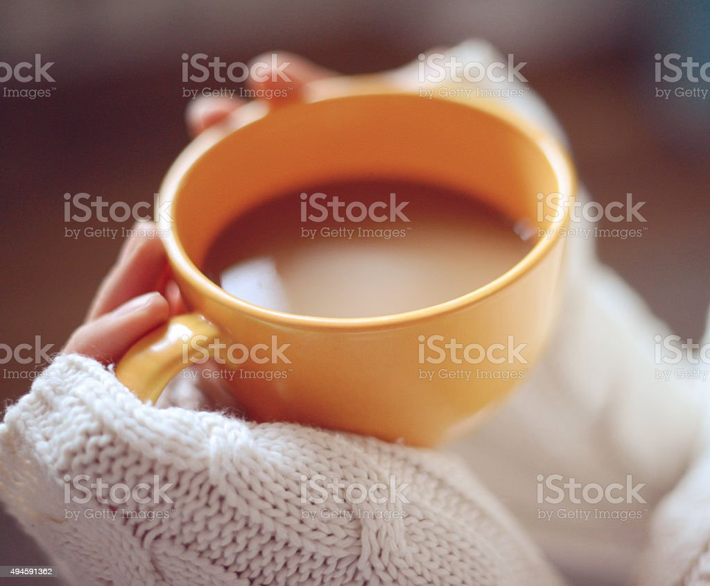 woman's hands holding a cup of coffee close-up stock photo