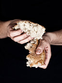 Woman's hands holding a pieces of bread
