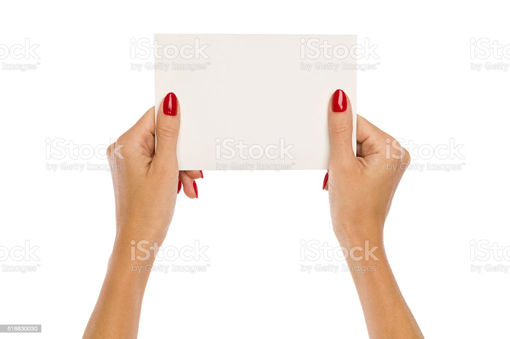 Woman's Hands Holding Blank Paper Sheet stock photo