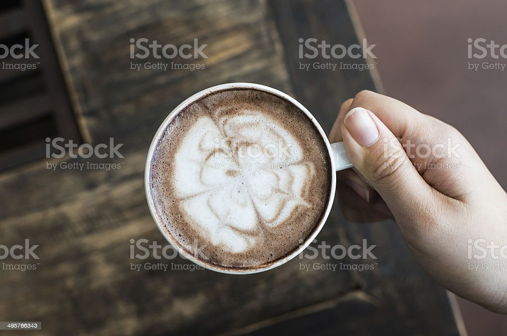 Woman's hands holding cup of coffee stock photo