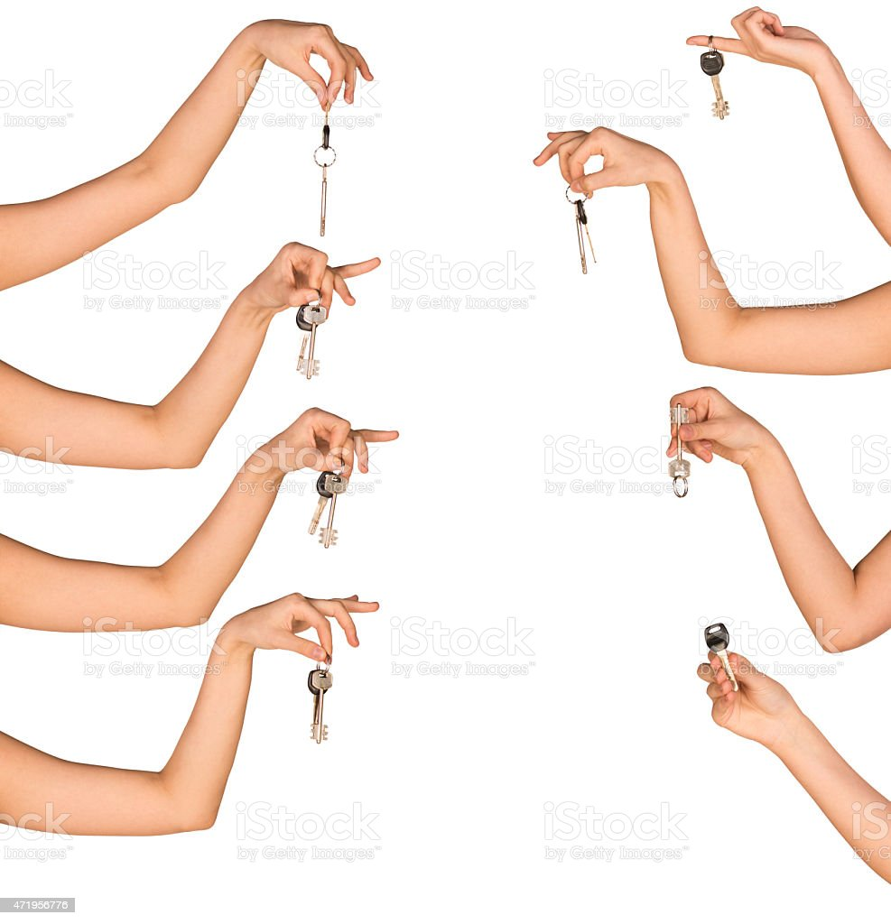Womans hands holding house keys on white isolated background stock photo