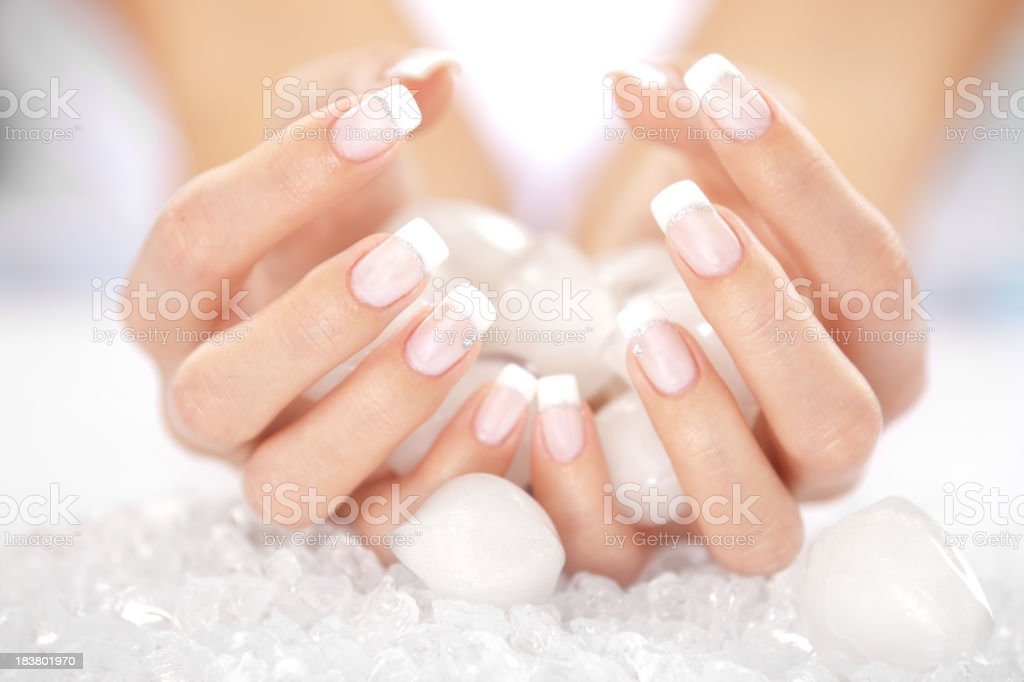Woman's hands holding ice cubes royalty-free stock photo