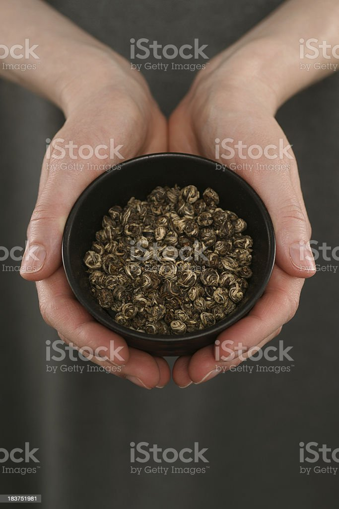 Woman's Hands Holding Jasmine Tea Pearls stock photo