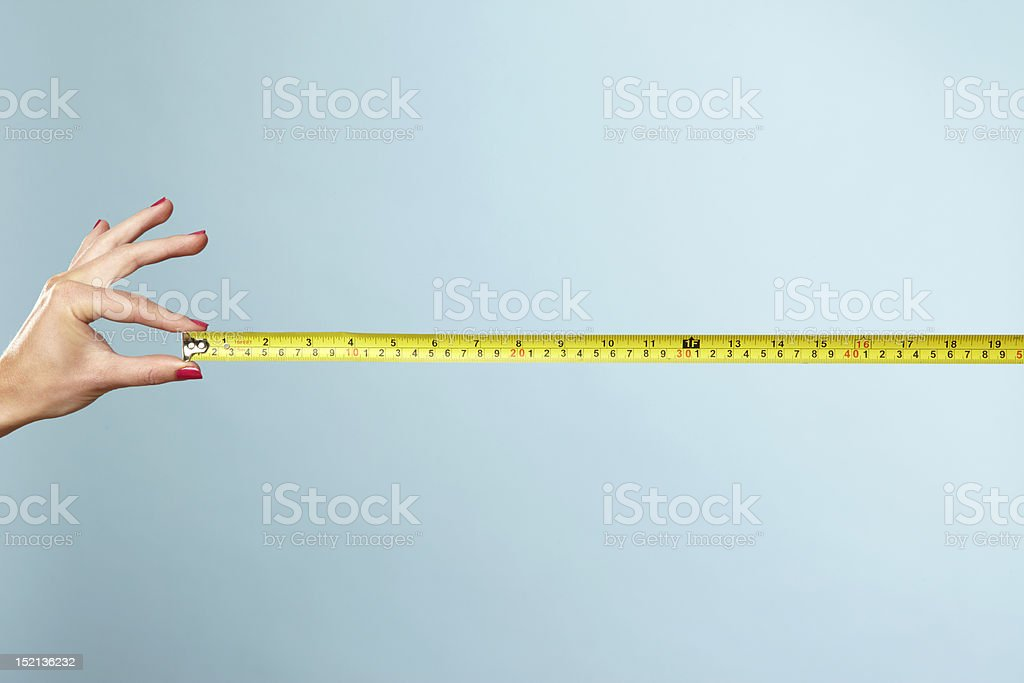 Woman's hands holding tape measure stock photo