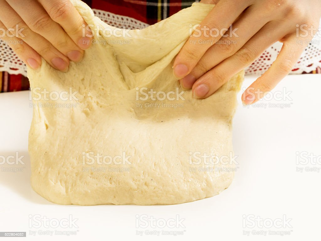 Woman's hands knead dough. royalty-free stock photo