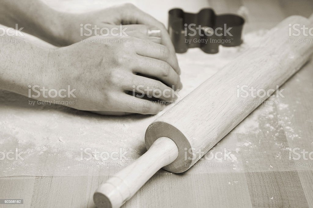 Woman's hands kneading dough stock photo