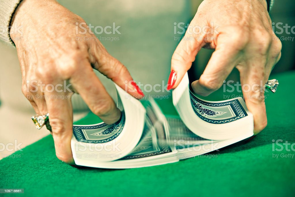 Woman's Hands Mixing and Shuffling Deck of Cards stock photo