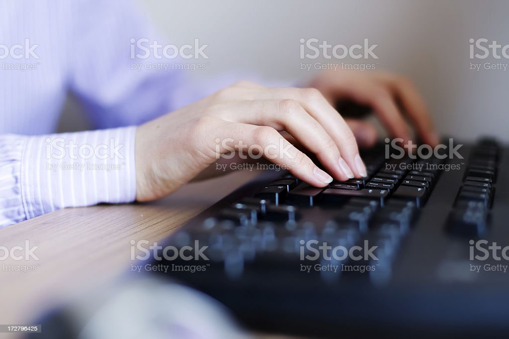 woman's hands on keyboard royalty-free stock photo