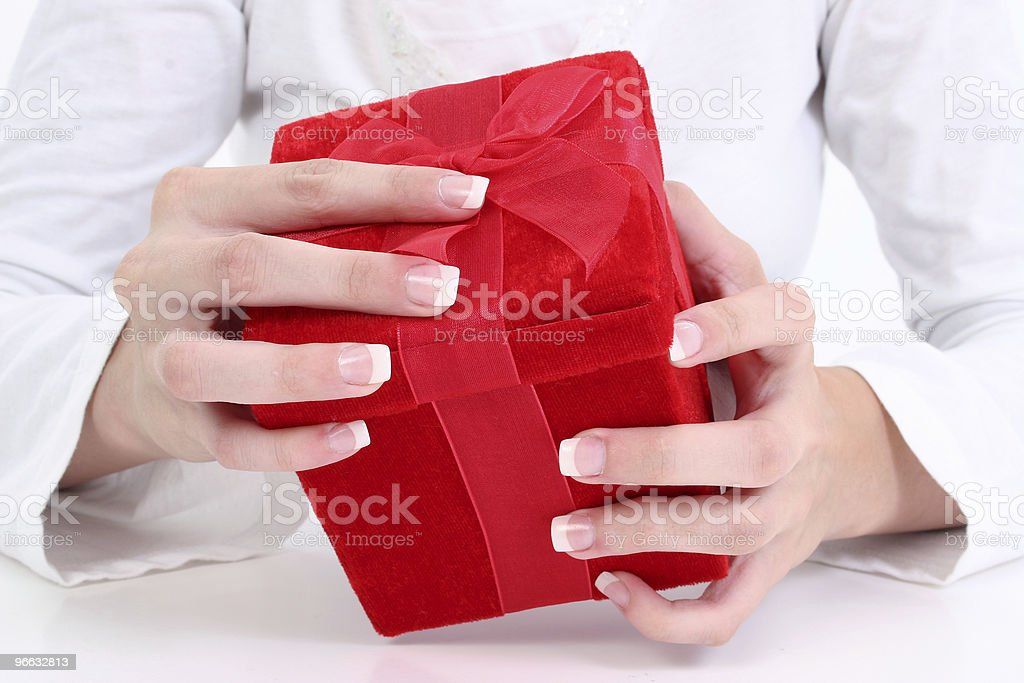 Woman's Hands On Red Velvet Gift Box royalty-free stock photo