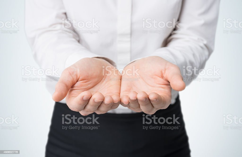 woman's hands, palms up. stock photo