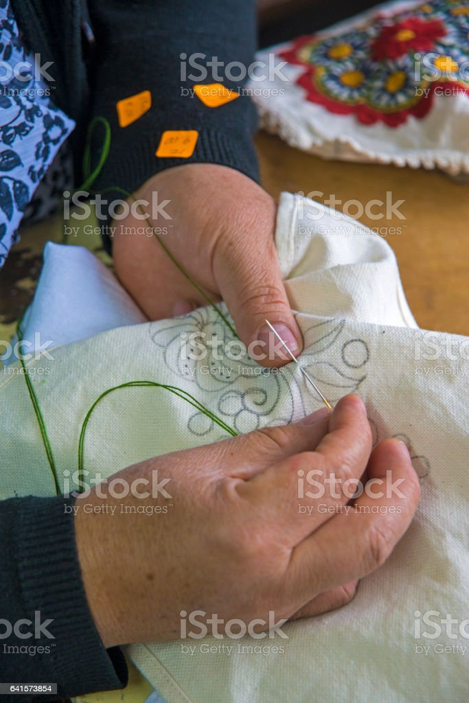 Woman's hands sewing stock photo