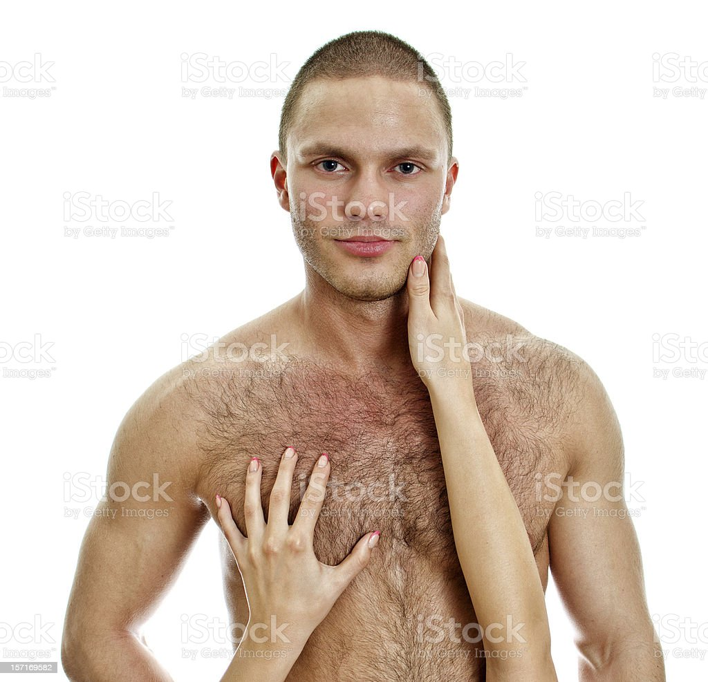 Woman's hands touching man's chest. stock photo