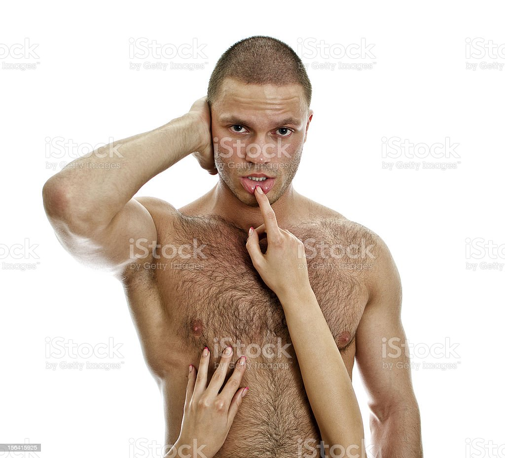 Woman's hands touching man's lips. Isolated on white. stock photo