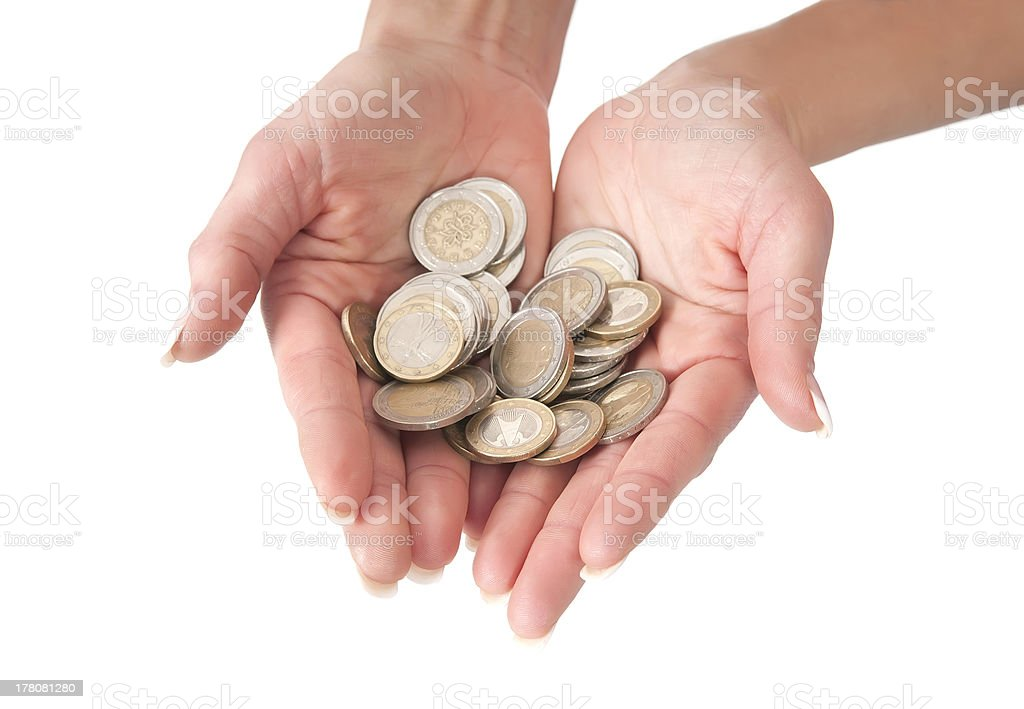 womans hands with coins stock photo