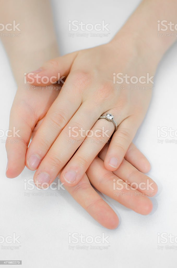 Woman's hands with engagement ring royalty-free stock photo