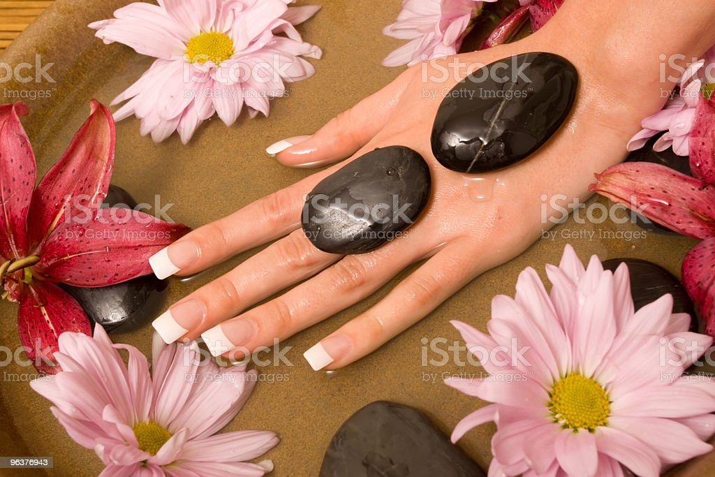 Woman's hands with French manicure in water royalty-free stock photo
