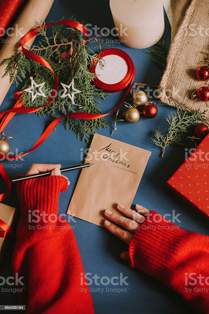 Woman's hands writing a letter stock photo