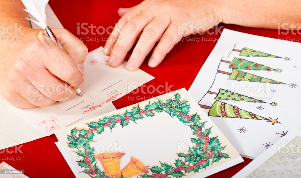 Womans Hands Writing Christmas Cards royalty-free stock photo