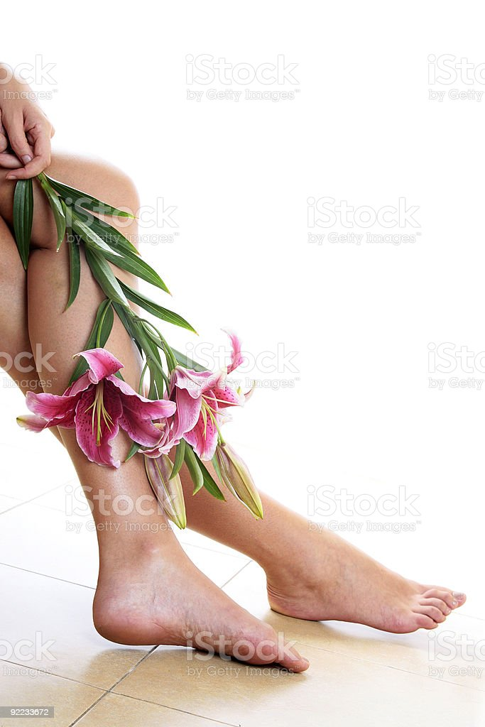 Womans legs and flowers royalty-free stock photo