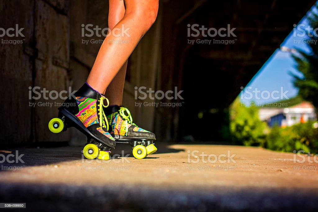 Woman's legs and roller skates stock photo