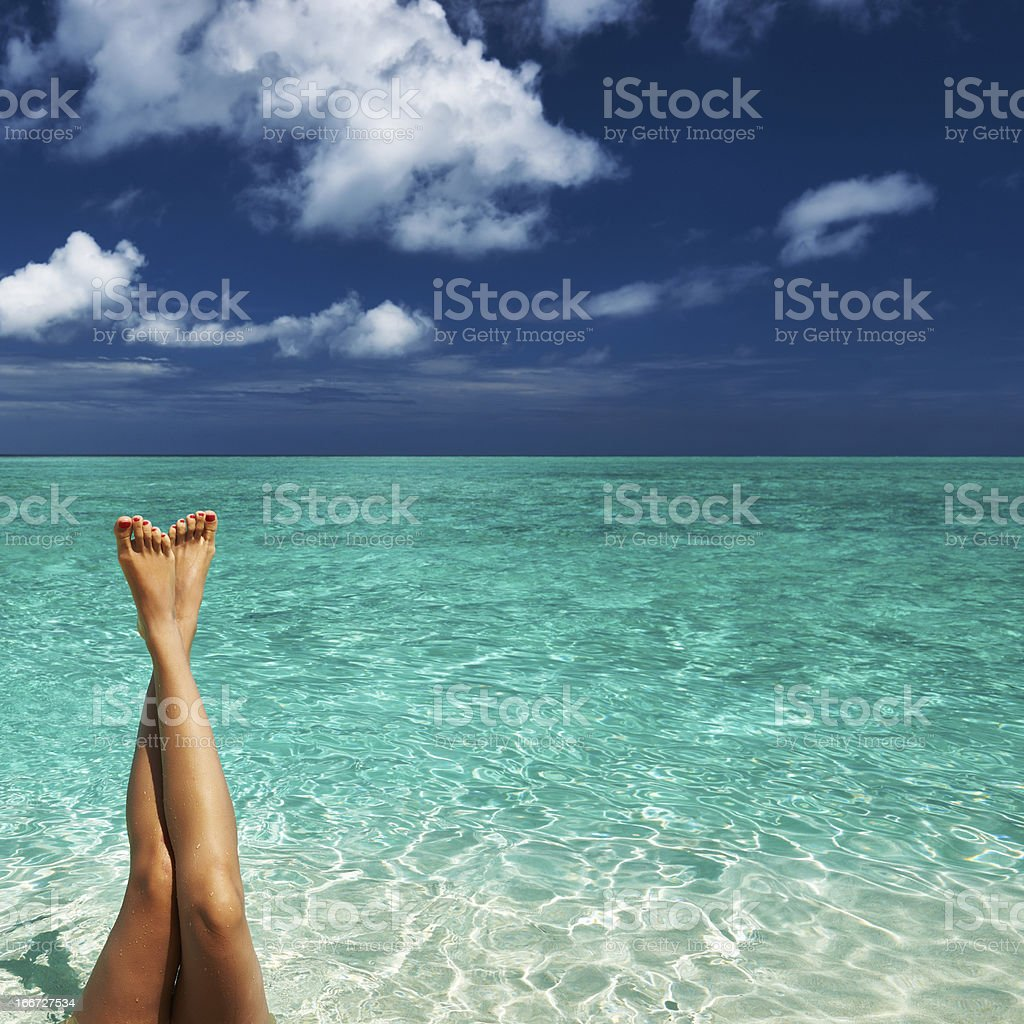 Woman's legs at beach royalty-free stock photo