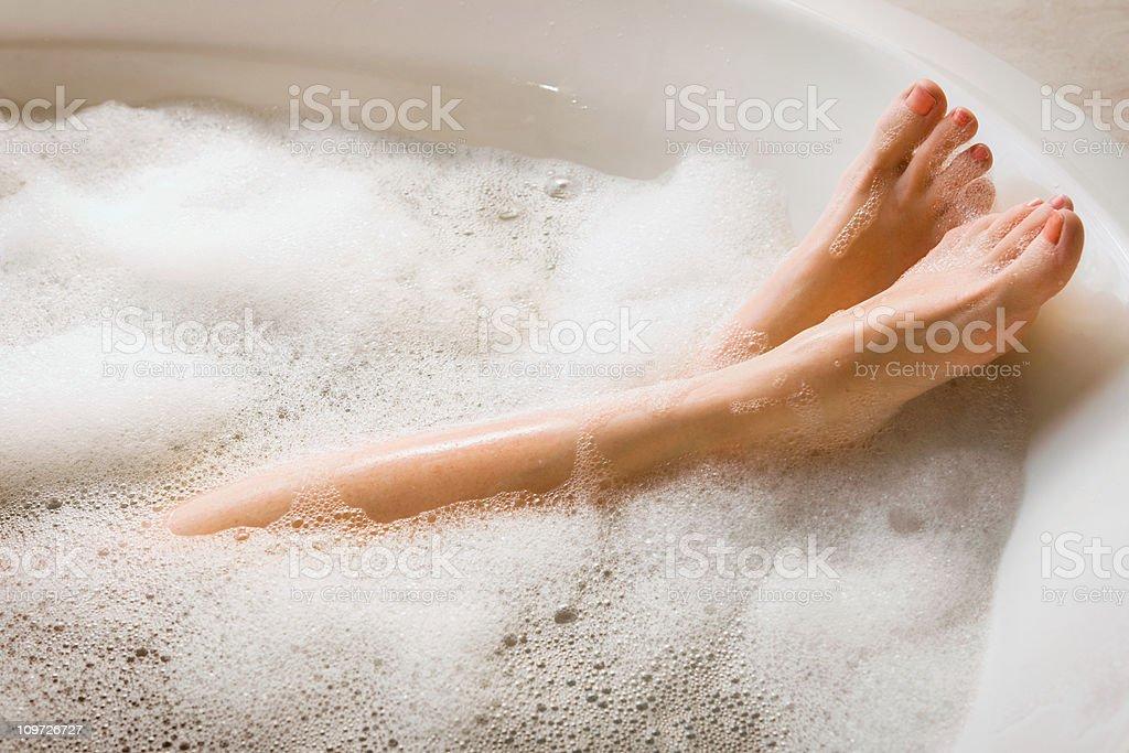 Woman's Legs & Feet in Bubble Bath stock photo