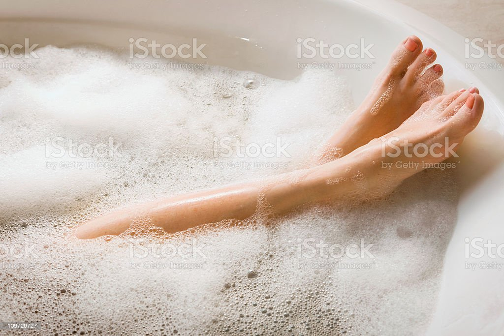 Woman's Legs & Feet in Bubble Bath stock photo