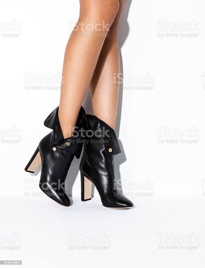 Woman's legs in black high heels stock photo