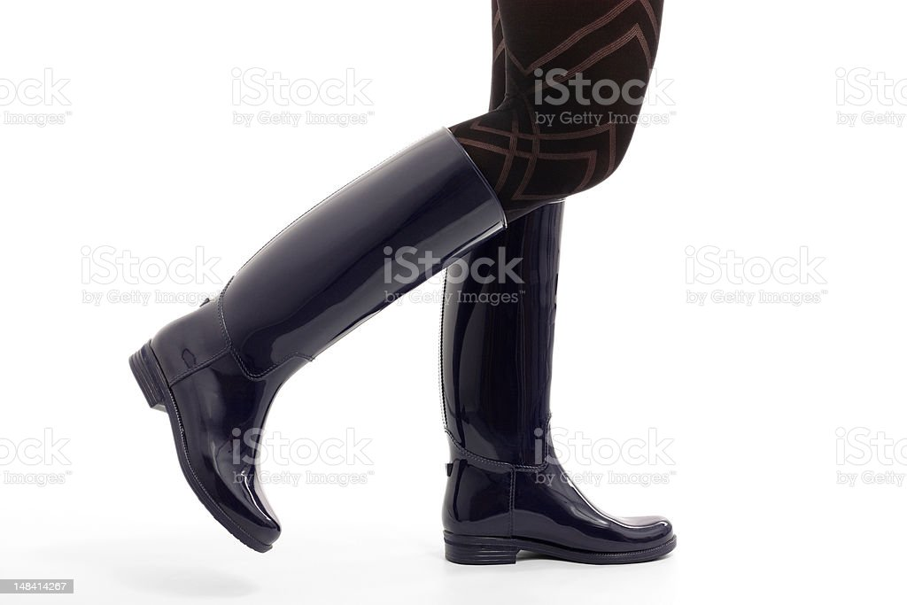 Woman's legs in Blue Wellingtons stock photo