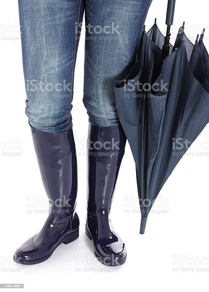 Woman's legs in Blue Wellingtons with Umbrella royalty-free stock photo