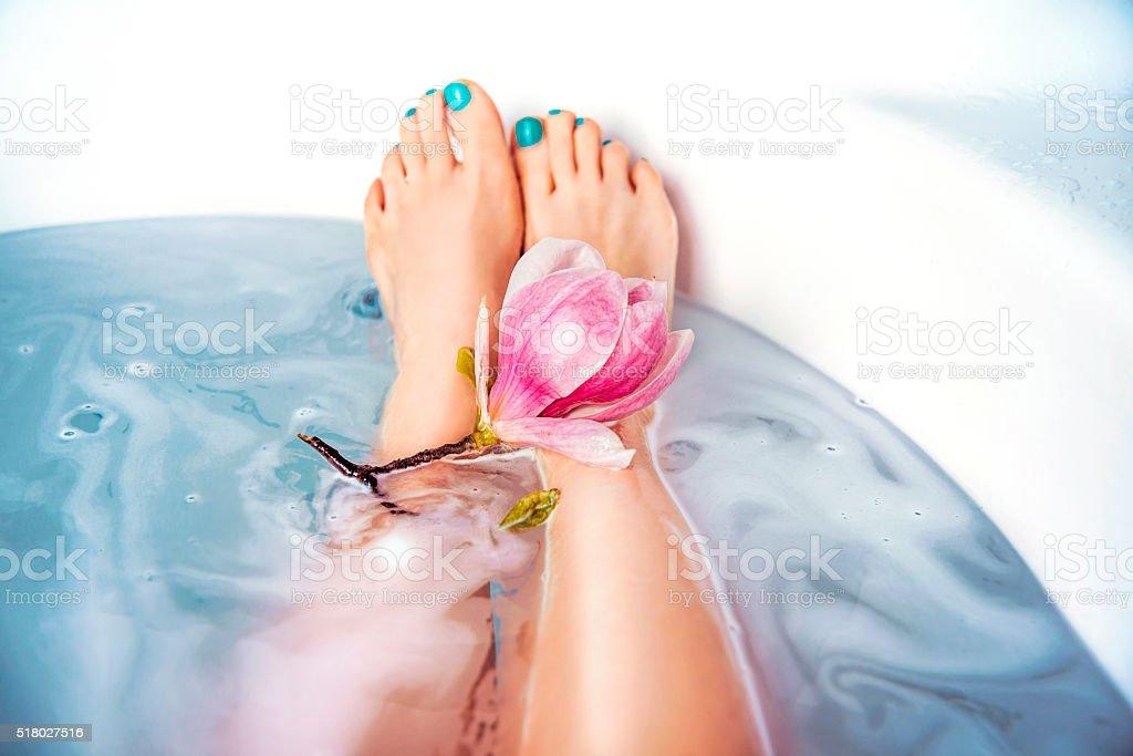Woman's Legs in Bubble Bath stock photo