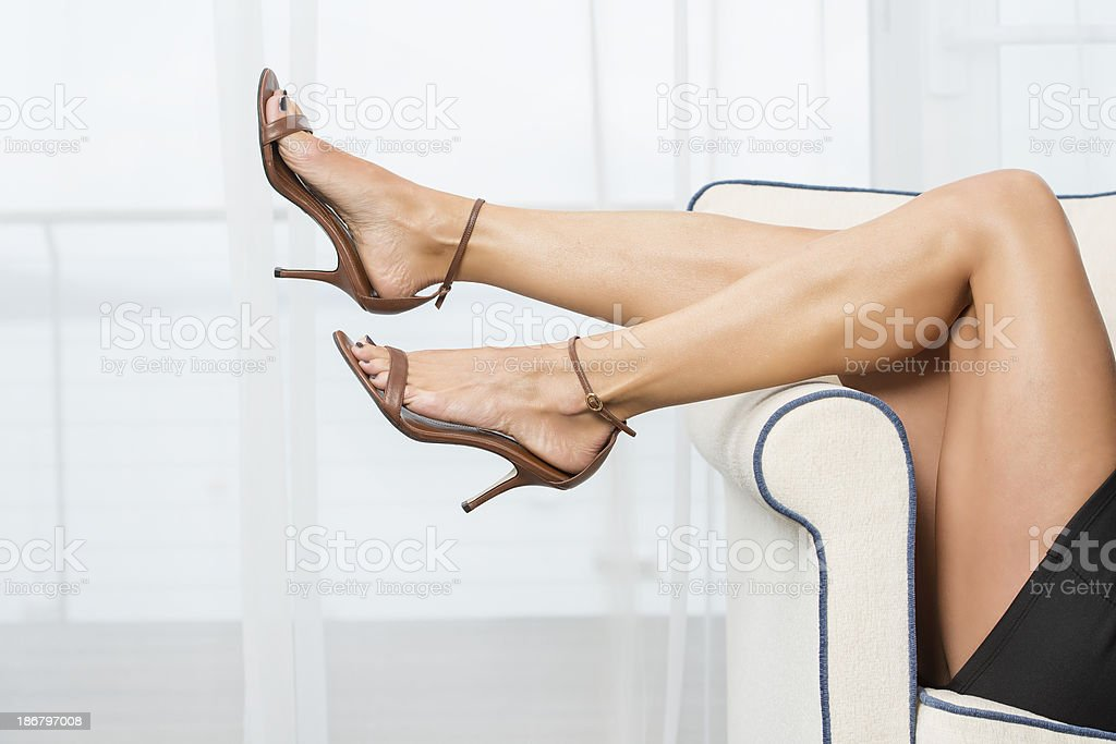 Woman´s legs in elegant High Heels sandals stock photo