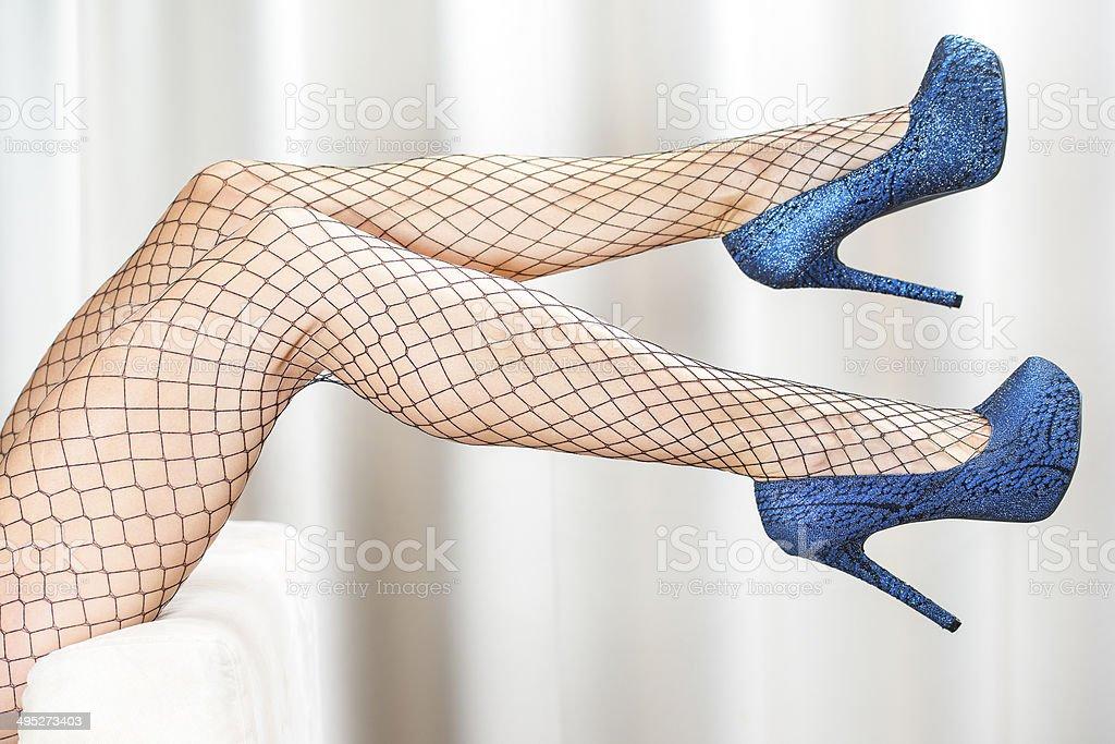 Woman?s legs in glitter blue platform High Heels stock photo