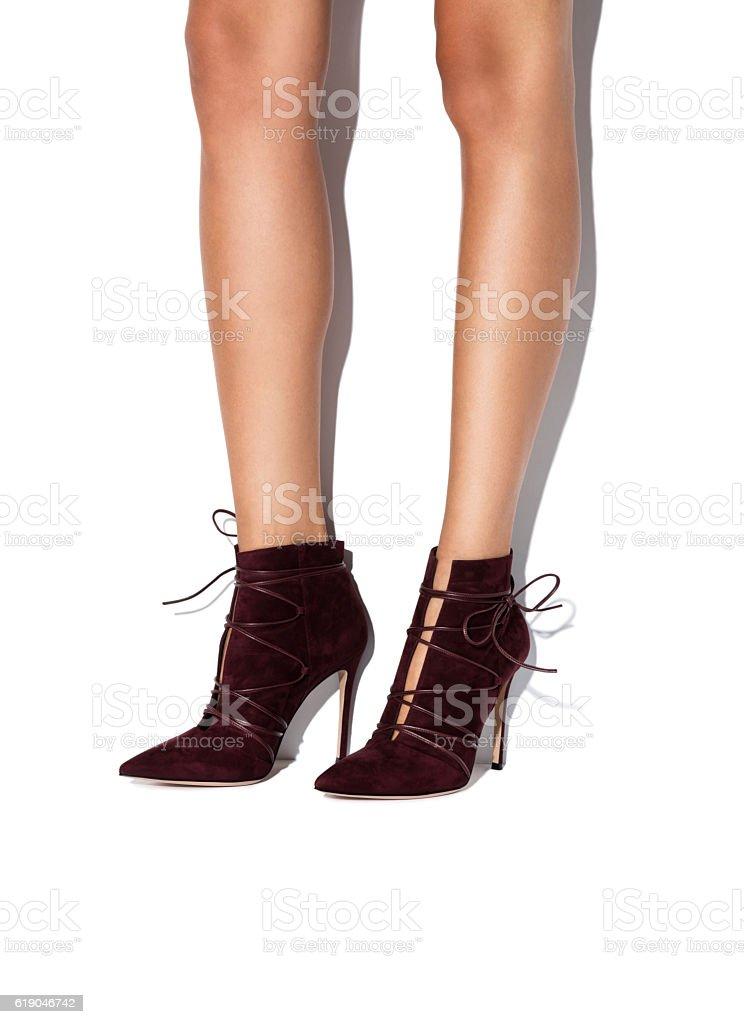 Woman's legs in high heels stock photo